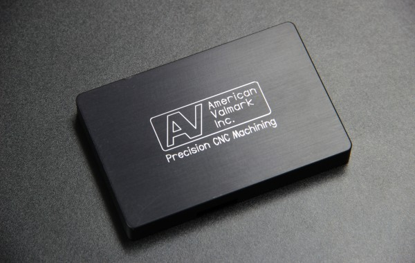 CNC milled aluminum with black anodized finish and custom engraving